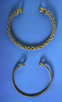 two gold torcs